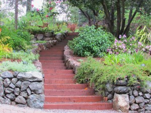 tie stairs surrounded by flowers and trees